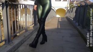 DANA LABO - I woman in rubberized leggings, high boots, I walk on the bridge of