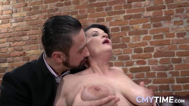 Granny fucks with a big cock very hardcore