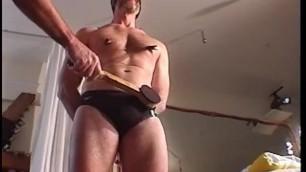 CBT bashing muscular stud's balls in his speedo.